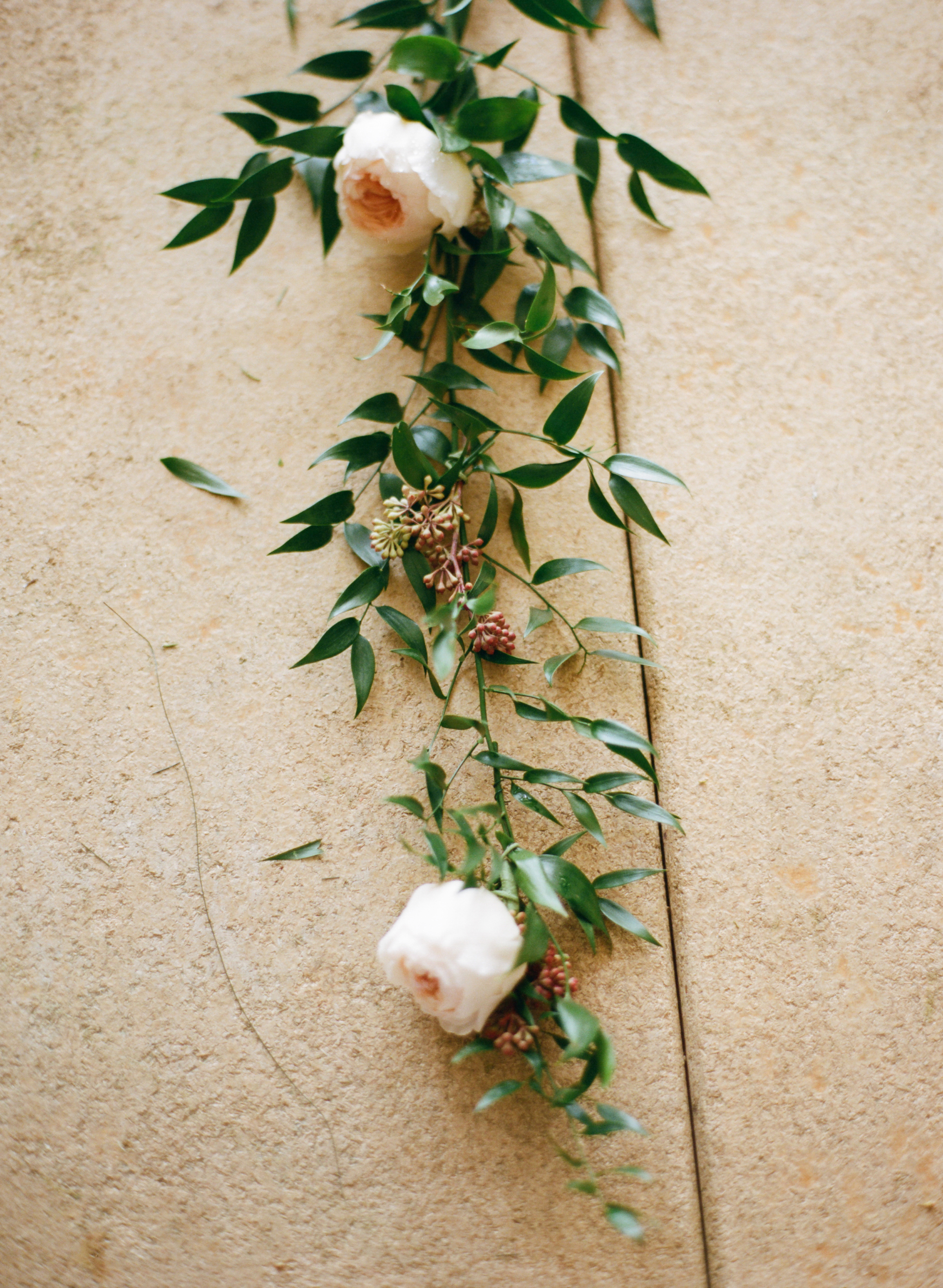Use An Additional Taped Wire Piece And Twist The Tightly Around Ruscus String Securing Garland