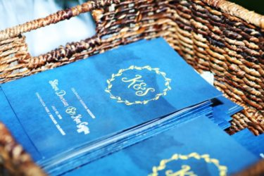 Blue wedding programs in basket