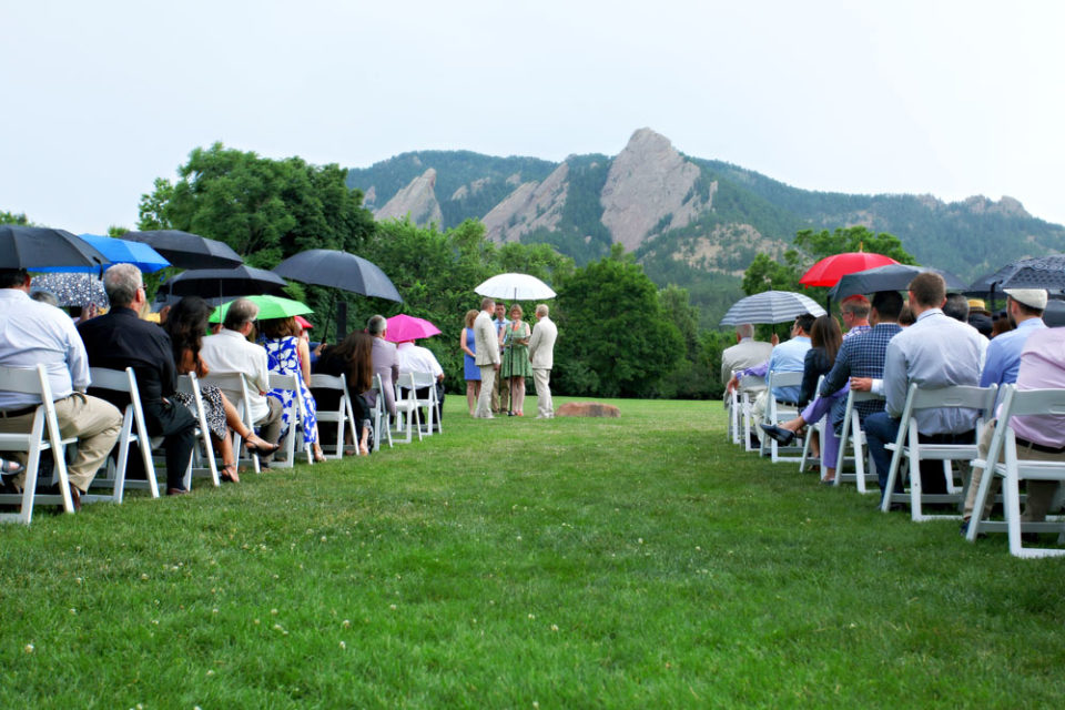Wedding ceremony flatirons boulder co umbrellas guests