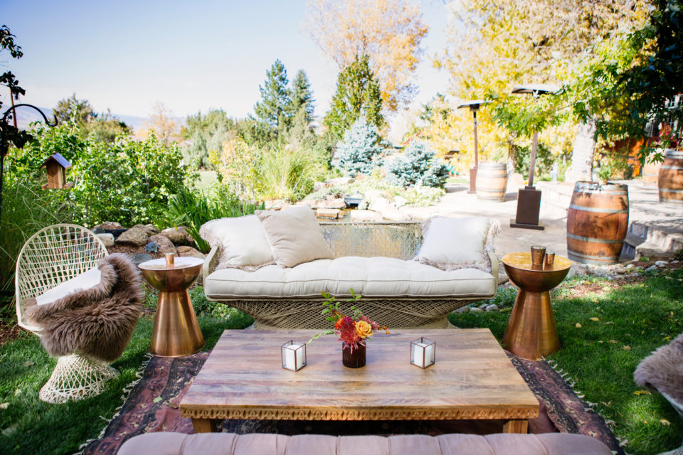 Wedding lounge furry blanket wood table backyard