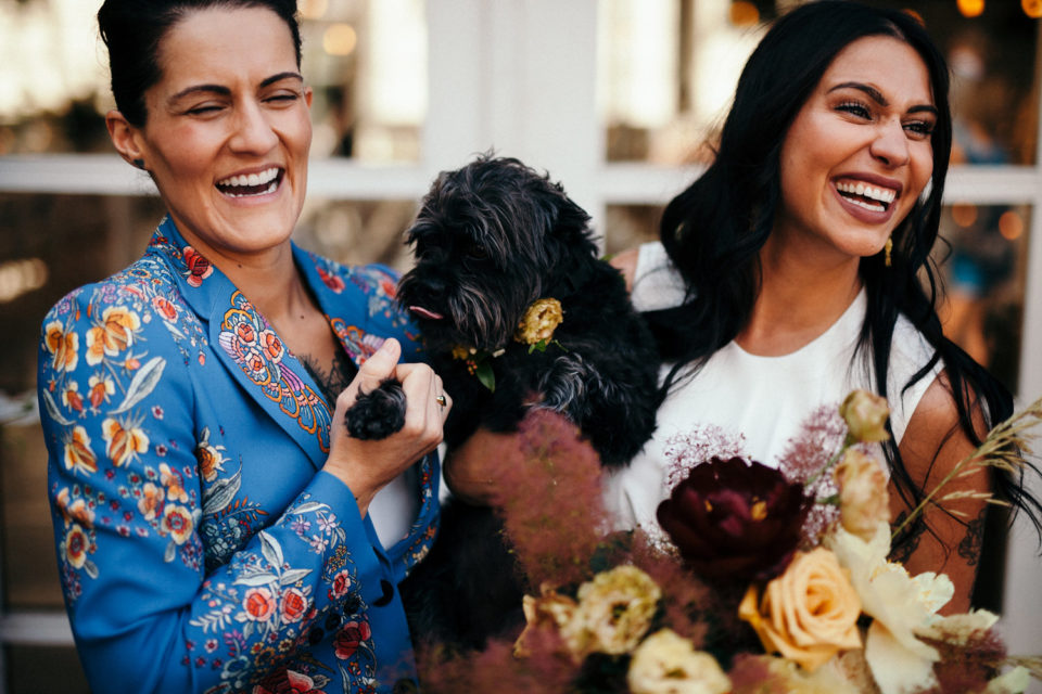 Brides with puppy laughing bouquets