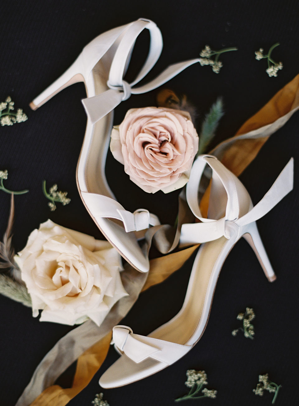Shoes and flowers details Devil's Thumb Ranch wedding