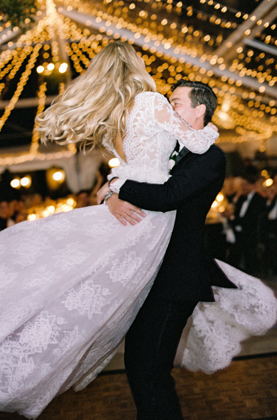 bride groom twirling reception vail