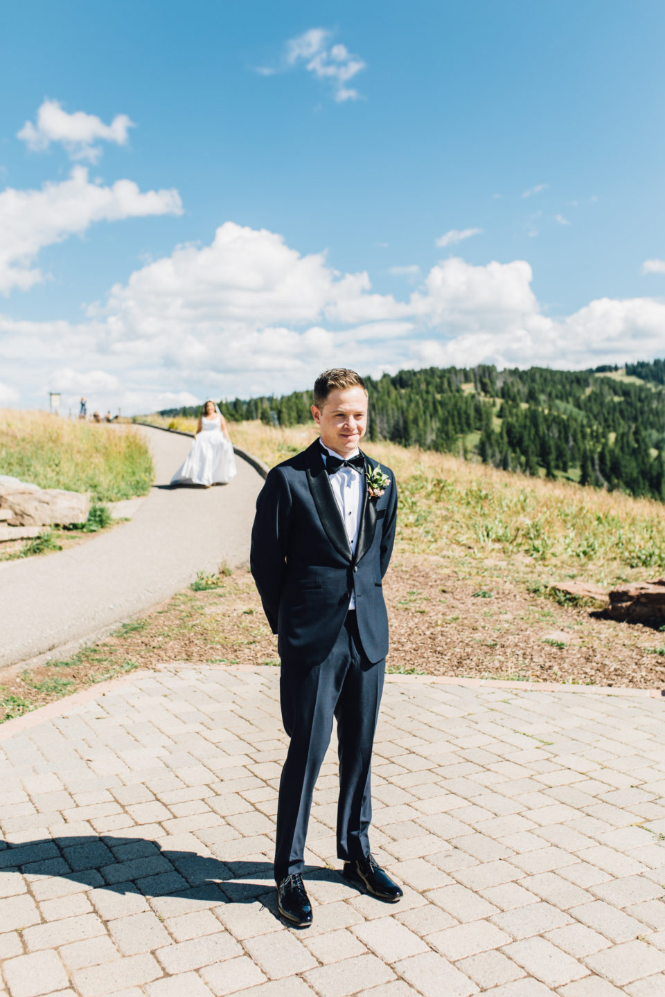 groom waiting for bride first look vail mountain deck