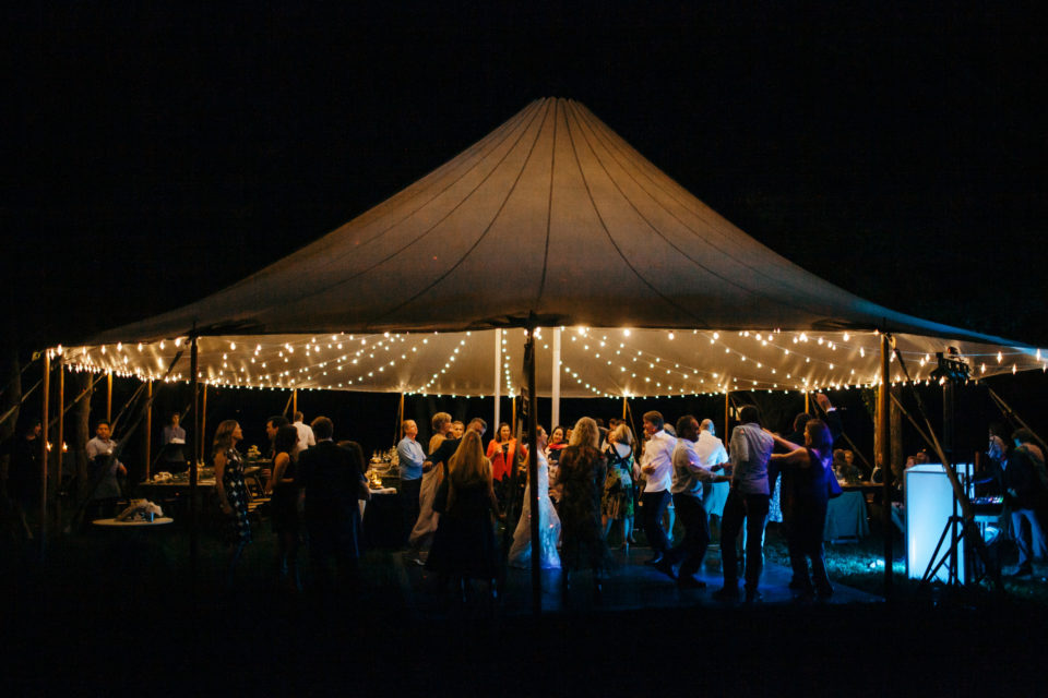 summer night wedding tent glow reception dancing