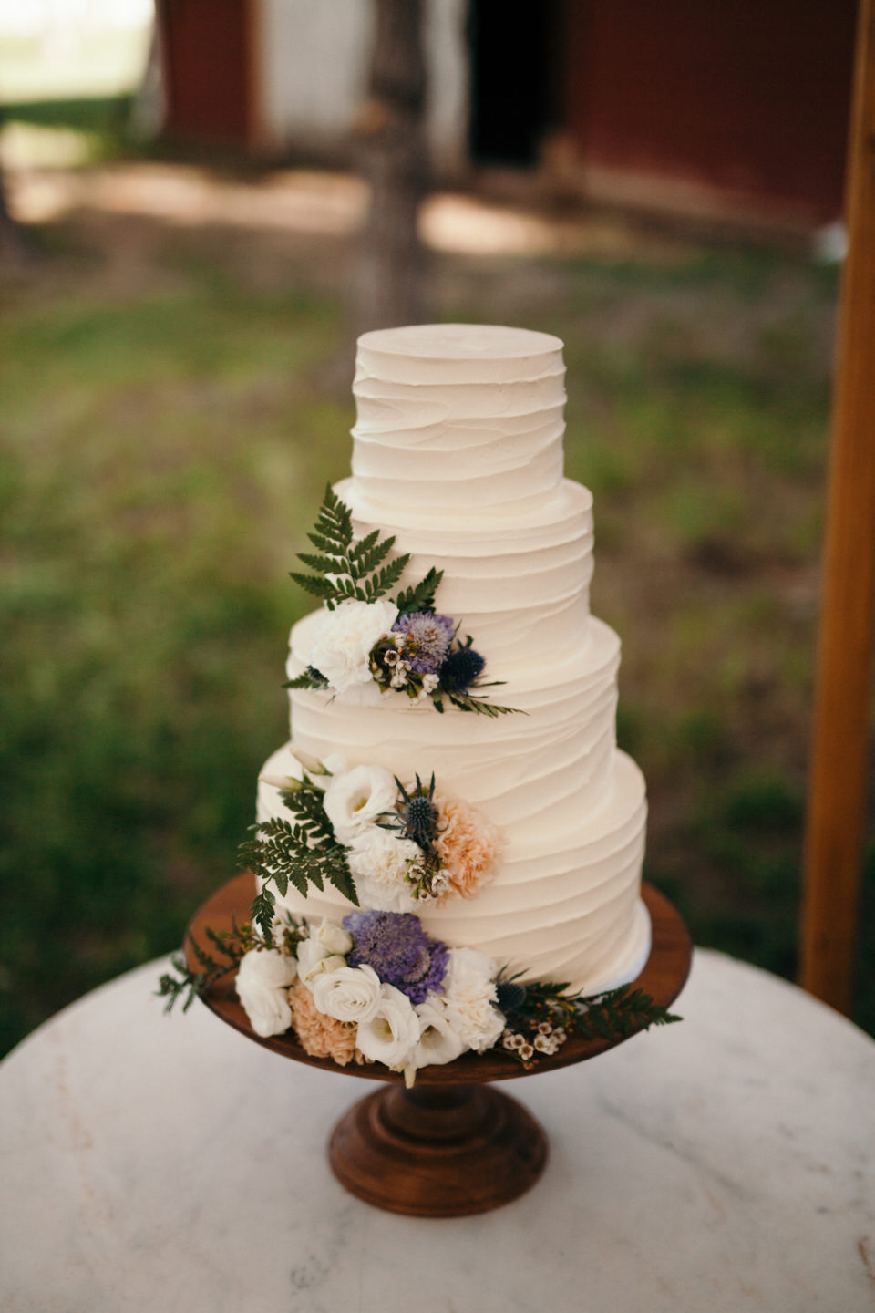 simple wedding cake decorated with loose florals