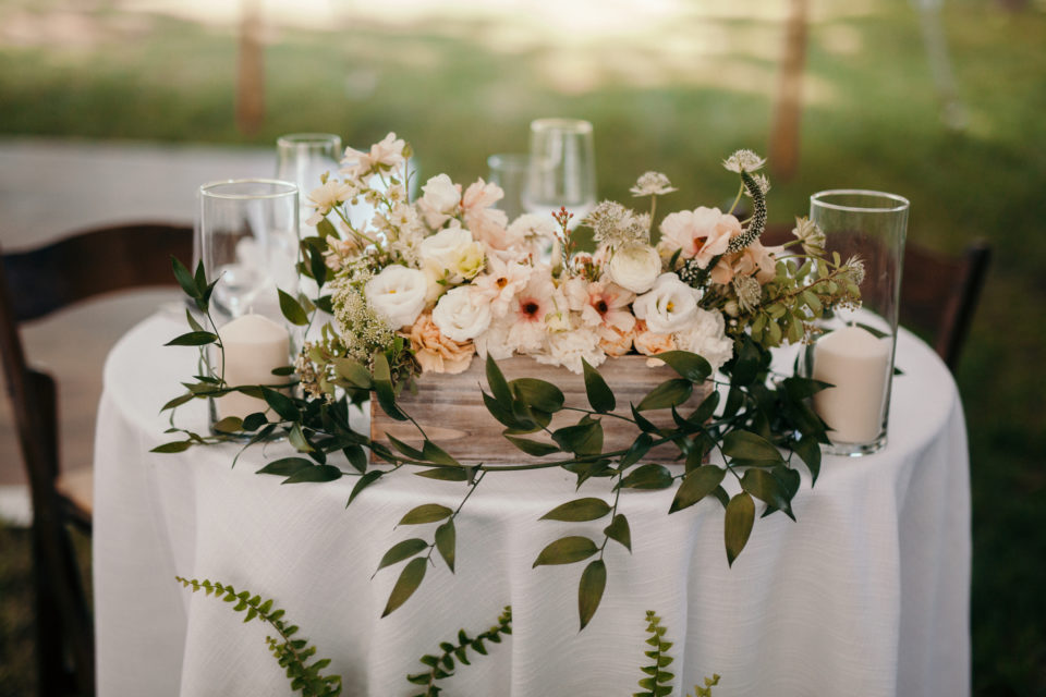 sweetheart table organic florals smilax soft blush reception decor