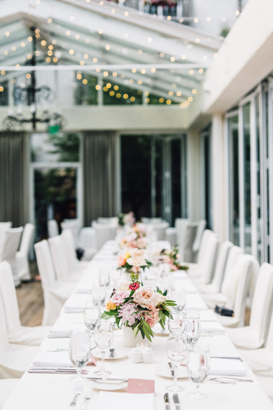 bright open room soft floral reception decor