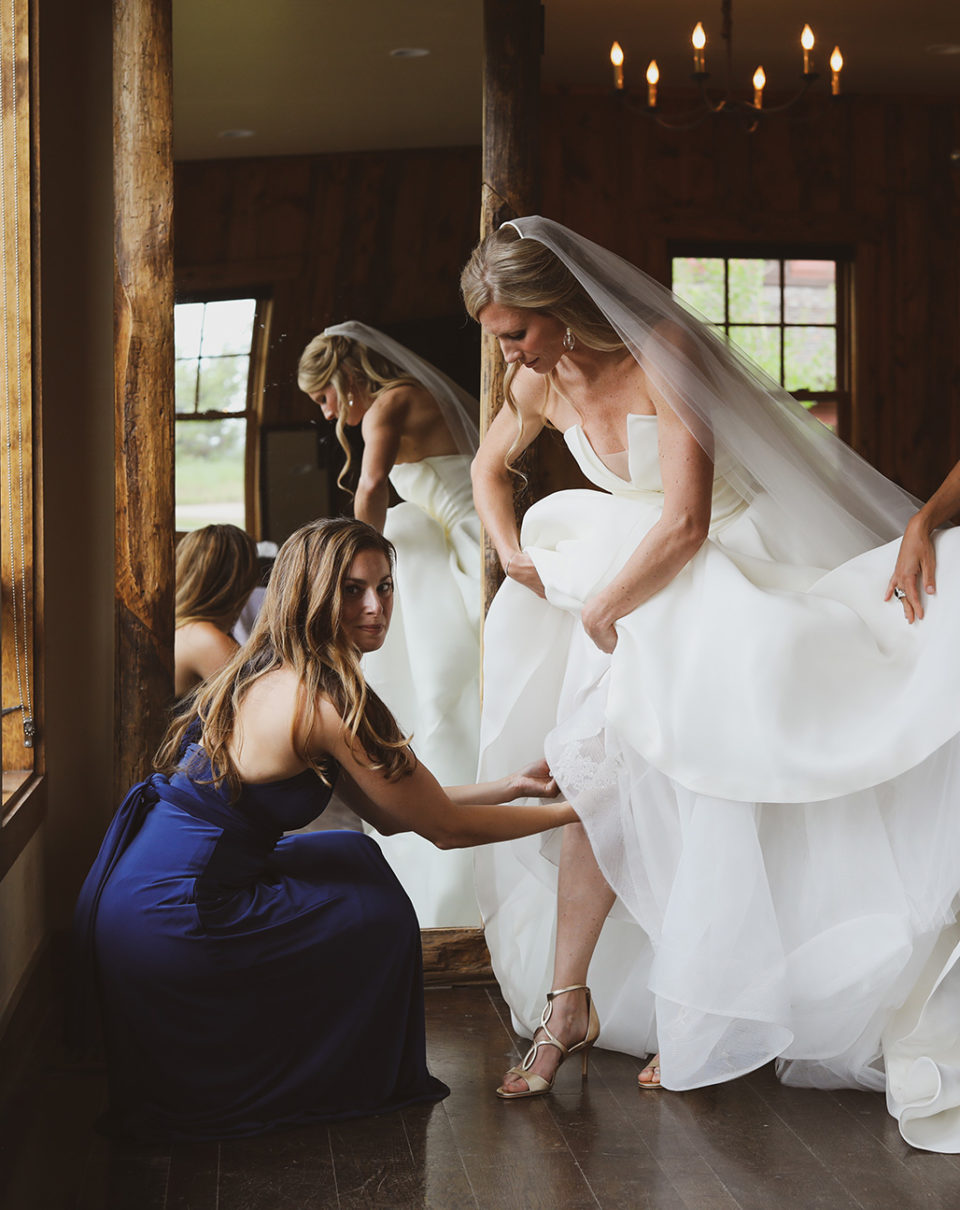 bride stepping into her gown getting ready