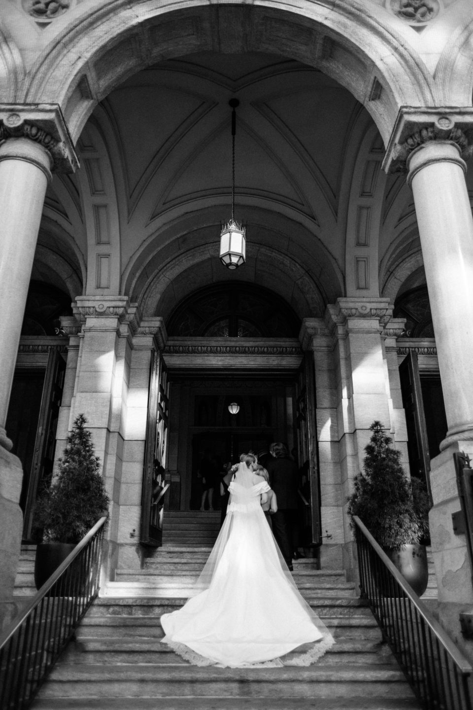 bride walking up steps st xavier francis church nyc wedding