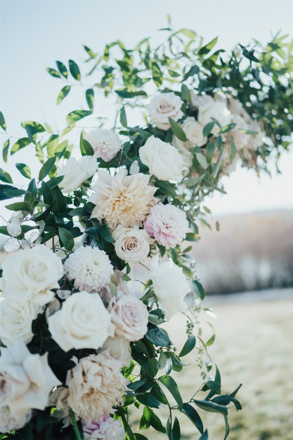 blush and white floral arch