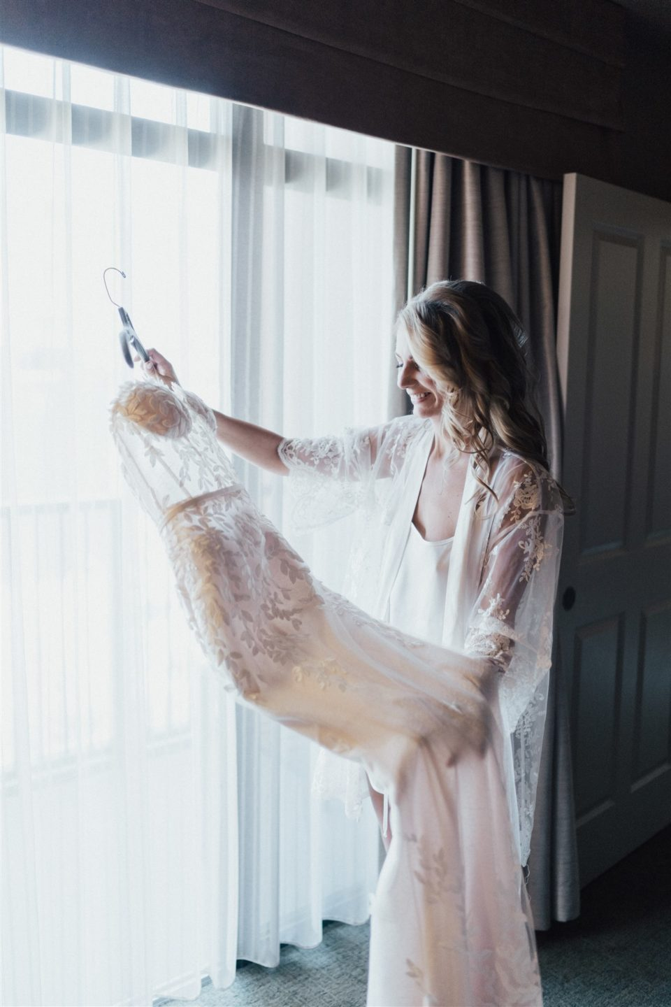 bride getting ready lace gown