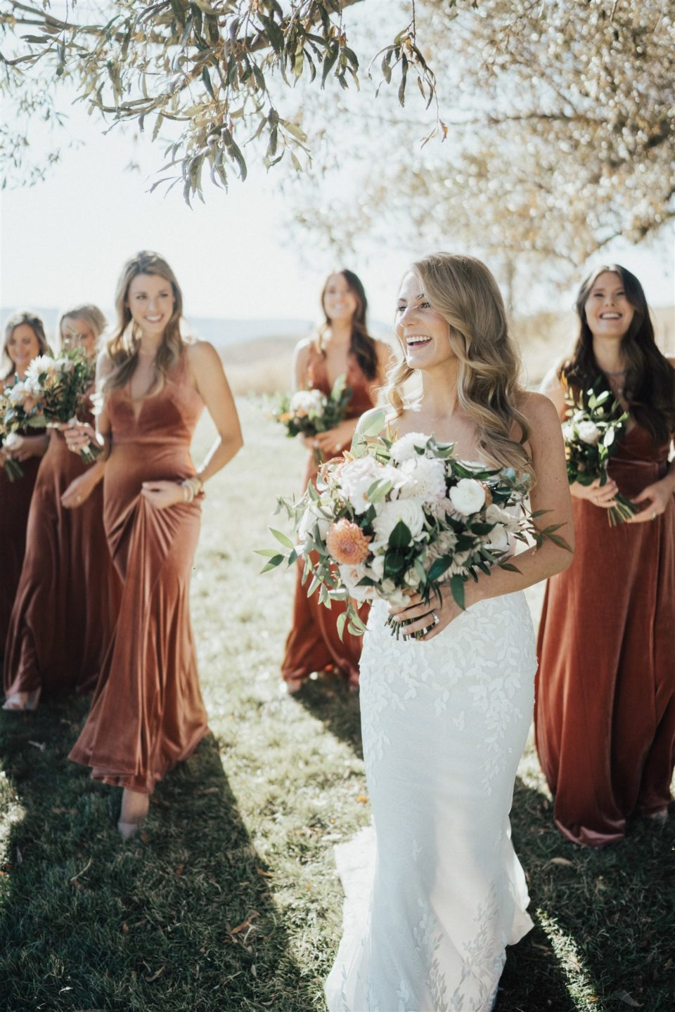 bride and bridesmaids rust colored velvet dresses